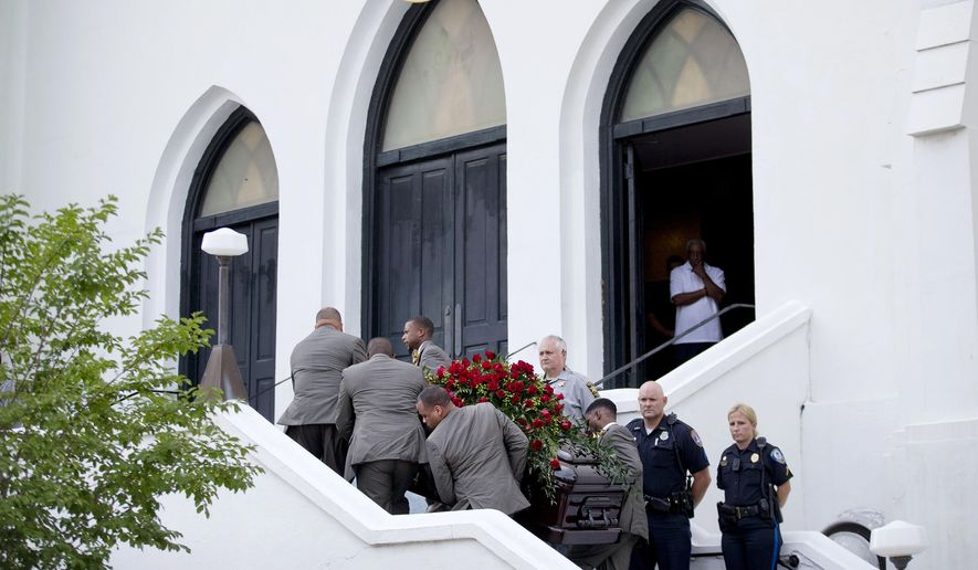 Pallbearers carry the casket of Sen. Clementa Pinckney, one of the nine killed in last week's shooting, into Emanuel AME Church for his wake, Thursday, June 25, 2015, in Charleston, S.C. President Barack Obama will deliver the eulogy at Pinckney's funeral Friday at a nearby college arena. (AP Photo/David Goldman)