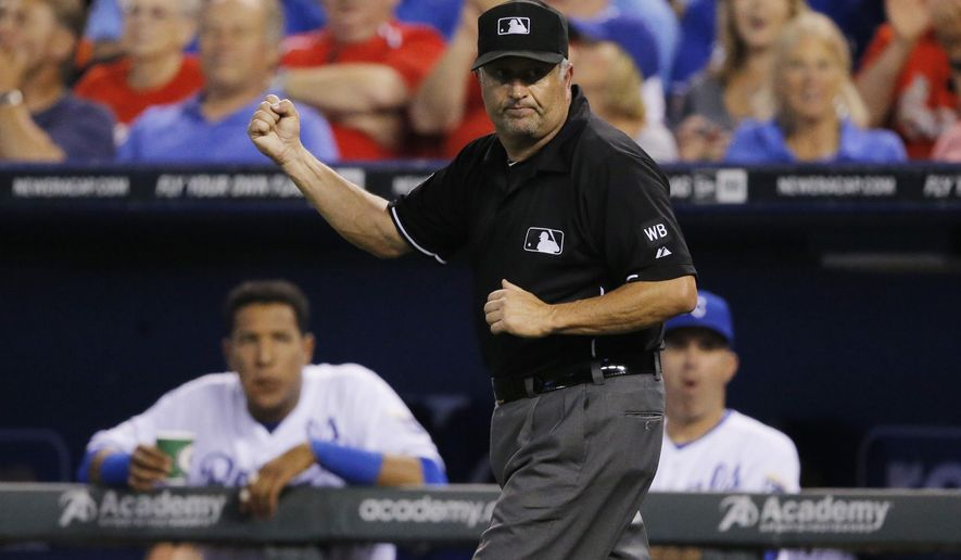 """FILE - In this June 4, 2014, file photo, umpire Dale Scott makes a call after review during a baseball game between the St. Louis Cardinals and Kansas City Royals at Kauffman Stadium in Kansas City, Mo. Dale Scott, who came out as gay last winter, called Friday's Supreme Court ruling """"one of the biggest civil rights victories that this country has seen."""" (AP Photo/Orlin Wagner, File)"""