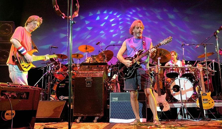 FILE - In this Aug. 3, 2002 file photo, The Grateful Dead, from left, Phil Lesh, Bill Kreutzmann, Bob Weir and Mickey Hart perform during a reunion concert in East Troy, Wis. The group  will perform three shows from July 3-5 at Soldier Field in Chicago. (AP Photo/Morry Gash, File)