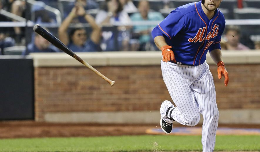 New York Mets' Lucas Duda tosses his bat after Cincinnati Reds starting pitcher Johnny Cueto walked him during the fifth inning of a baseball game with the bases loaded Friday, June 26, 2015, in New York. (AP Photo/Frank Franklin II)