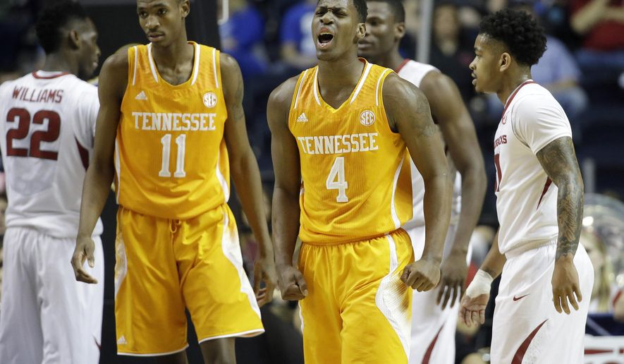 FILE - In this March 13, 2015, Tennessee forward Armani Moore (4) reacts against Arkansas during the first half of an NCAA college basketball game in the quarterfinal round of the Southeastern Conference tournament in Nashville, Tenn. Moore's college career has taught him plenty about how to adjust to change. The 6-foot-5 forward plans to apply those lessons in his senior as he leads a team adjusting to its third coach in as many seasons. (AP Photo/Mark Humphrey, File)