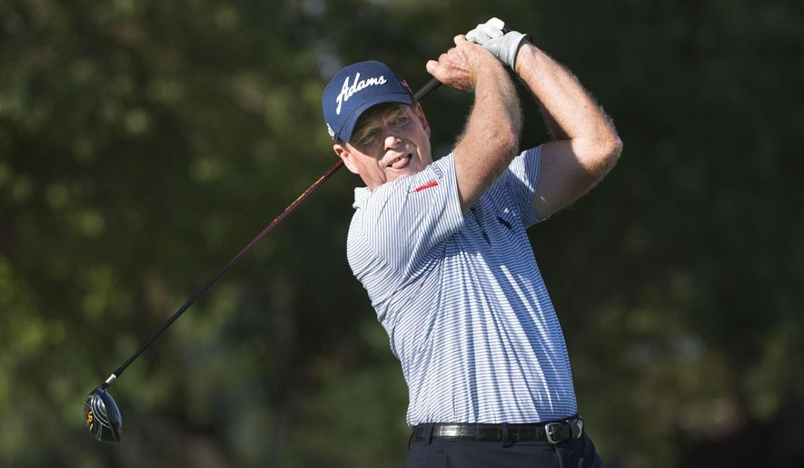 Tom Watson tees off on the 18th hole during the second round of the U.S. Senior Open golf tournament at Del Paso Country Club on Friday, June 26, 2015, in Sacramento, Calif. (Randy Pench/The Sacramento Bee via AP)