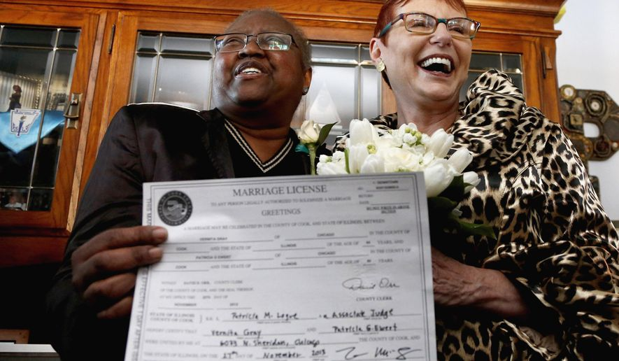 FILE - In this Nov. 27, 2013 file photo, Vernita Gray, left, and Patricia Ewert, hold their Illinois marriage license at their home in Chicago following their marriage by a Cook County judge. They were the first couple to be married after the gay marriage law was signed by the governor. Ewert and Gray, were granted an exception to marry before Illinois' law formally took effect because Gray was terminally ill with cancer. They married in November 2013 and Gray died the following March, three months before the law went into effect. Ewert says the Supreme Court's legalization of same-sex marriages across the country Friday June 26, 2015 is a victory her late wife is no doubt celebrating in heaven.   (AP Photo/Charles Rex Arbogast, File)