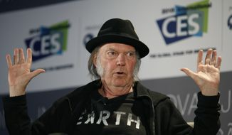 In this Jan. 7, 2015, file photo, Musician Neil Young speaks during a session at the International CES, in Las Vegas. (AP Photo/John Locher, File)