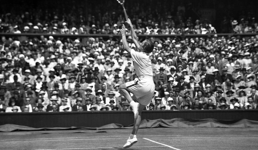 FILE - In this July 6, 1935 file photo, Helen Wills Moody regains the women's singles championship when she defeated Helen Jacobs in the final at the All England Lawn Tennis Championships in Wimbledon, London. Wills Moody won eight Wimbledon titles in an 11-year span, with her final victory coming in 1938. The California-born Wills Moody is considered to be one of the greatest female players in history with 31 Grand Slam titles in all forms. She also won two Olympic gold medals at the 1924 Paris Olympics, the last time tennis was an Olympic sport before being reintroduced at the 1988 Seoul Games. (AP Photo, File)