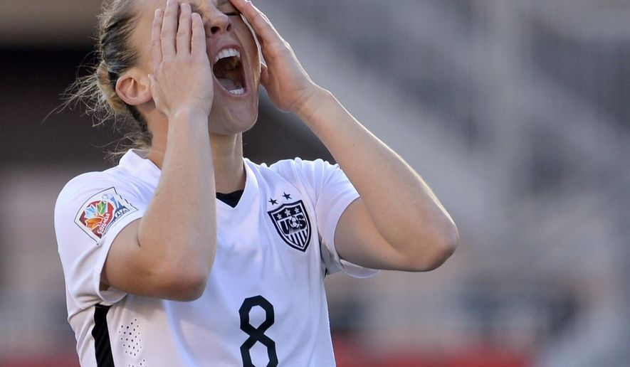 United States' Amy Rodriguez reacts after missing on a shot against China during the first half of a quarterfinal match in the FIFA Women's World Cup soccer tournament, Friday, June 26, 2015, in Ottawa, Ontario, Canada. (Adrian Wyld/The Canadian Press via AP)