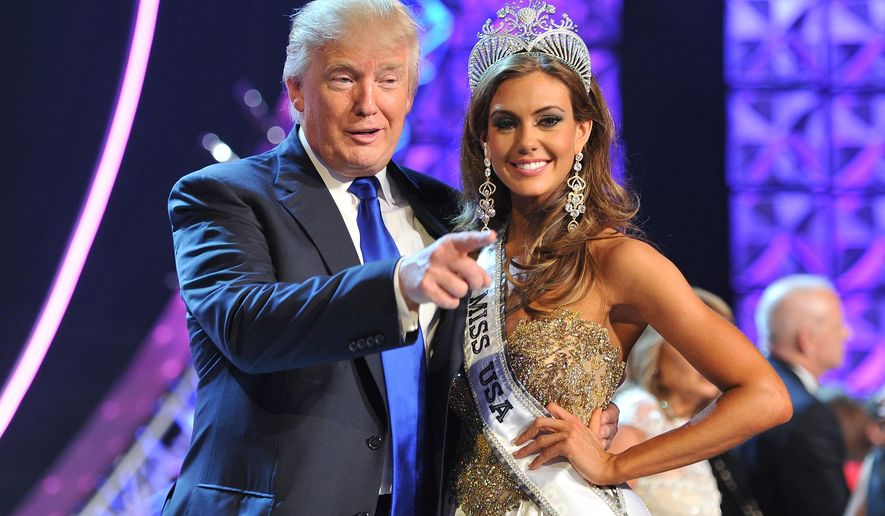 "FILE - In this June 16, 2013 file photo, Donald Trump, left, and Miss Connecticut USA Erin Brady pose onstage after Brady won the 2013 Miss USA pageant in Las Vegas, Nev. Univision says it is dropping the Miss USA Pageant and says it will cut all business ties with Donald Trump over comments he made about Mexican immigrants. The network said Thursday, June 25, 2015, it will not air the pageant on July 12, as previously scheduled, and has ended its business relationship with the Miss Universe Organization due to what it called ""insulting remarks about Mexican immigrants"" by Trump, a part owner. (AP Photo/Jeff Bottari, File)"