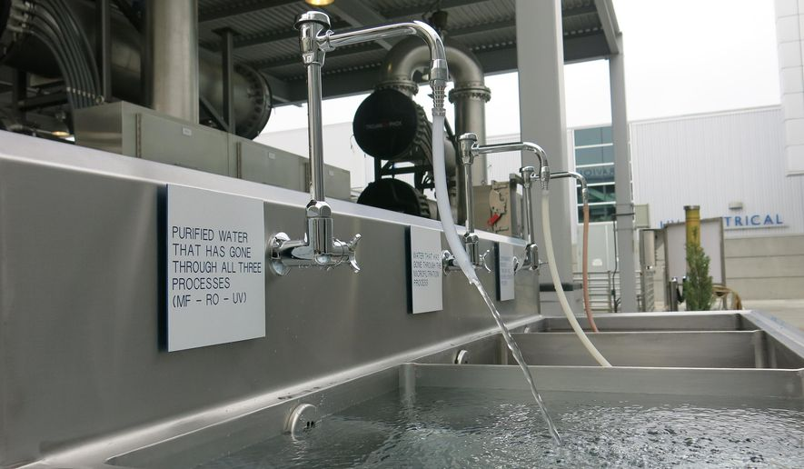 A purified water flows at the Orange County Water District, OCWD water plant, which purifies treated wastewater for release into the groundwater basin in Fountain Valley, Calif., on Friday, June 26, 2015. The Groundwater Replenishment System, GWRS takes highly treated wastewater and purifies it through a three-step process of microfiltration, reverse osmosis and ultraviolet light with hydrogen peroxide, resulting in near distilled quality water. (AP Photo/Amy Taxin)