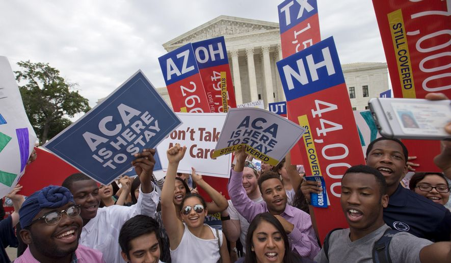 """Students cheer as they hold up signs stating that numbers of people in different states who would lose healthcare coverage, with the words """"lose healthcare"""" now over written with """"still covered"""" stickers, after the Supreme Court decided that the without the Affordable Care Act (ACA) may provide nationwide tax subsidies, Thursday June 25, 2015, outside of the Supreme Court in Washington. (AP Photo/Jacquelyn Martin)"""