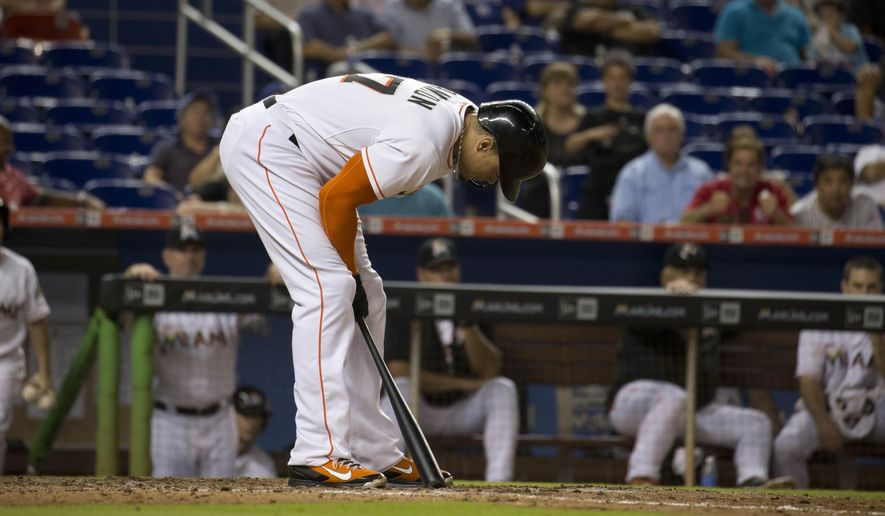 Miami Marlins' Giancarlo Stanton reacts after striking out during the ninth inning of a baseball game in Miami against the Los Angeles Dodgers, Friday, June 26, 2015. (AP Photo/J Pat Carter)