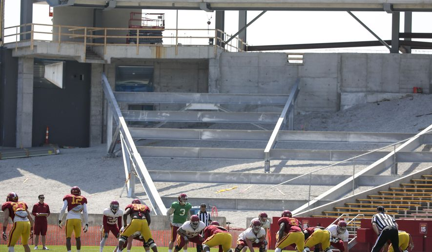 FILE - In this April 11, 2015, file photo, construction work continues in the south end zone of Jack Trice Stadium as the Iowa State football team playes during their spring NCAA college football game in Ames, Iowa. Guess who will have the Big 12's third-largest stadium in 2015? That would be Iowa State, a perpetually downtrodden program hoping to reverse a century of misery by investing in the future.  (AP Photo/Justin Hayworth, File)