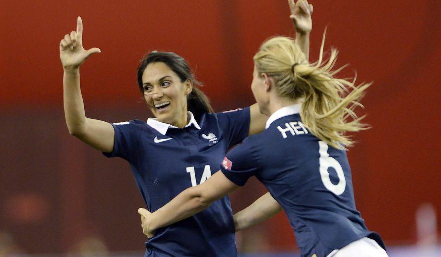 France's Louisa Necib, left, celebrates her goal against Germany with teammate Amandine Henry during the second half of a FIFA Women's World Cup quarterfinal soccer game, Friday, June 26, 2015, in Montreal, Canada. (Ryan Remiorz/The Canadian Press via AP) MANDATORY CREDIT