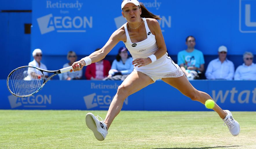 Poland's Agnieszka Radwanska in action during her victory over Sloane Stephens of the United States during day seven of the international women's tournament at Eastbourne, England, Friday June 26, 2015. (Gareth Fuller/PA via AP) UNITED KINGDOM OUT  NO SALES  NO ARCHIVE