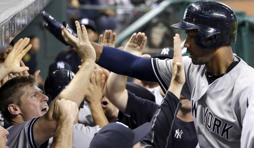 New York Yankees' Chris Young, right, is congratulated as he returns to the dugout after hitting a three-run home run against the Houston Astros during the seventh inning of a baseball game Friday, June 26, 2015, in Houston. (AP Photo/David J. Phillip)