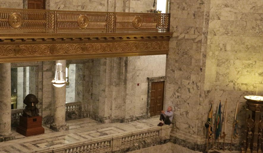 In this picture taken Friday, June, 26, 2015, Democratic Rep. Reuven Carlyle takes a break in the Capitol rotunda from budget negotiations in Olympia, Wash. A new two-year state budget must be adopted and signed before July 1 to avoid a partial government shutdown. (AP Photo/Rachel La Corte)
