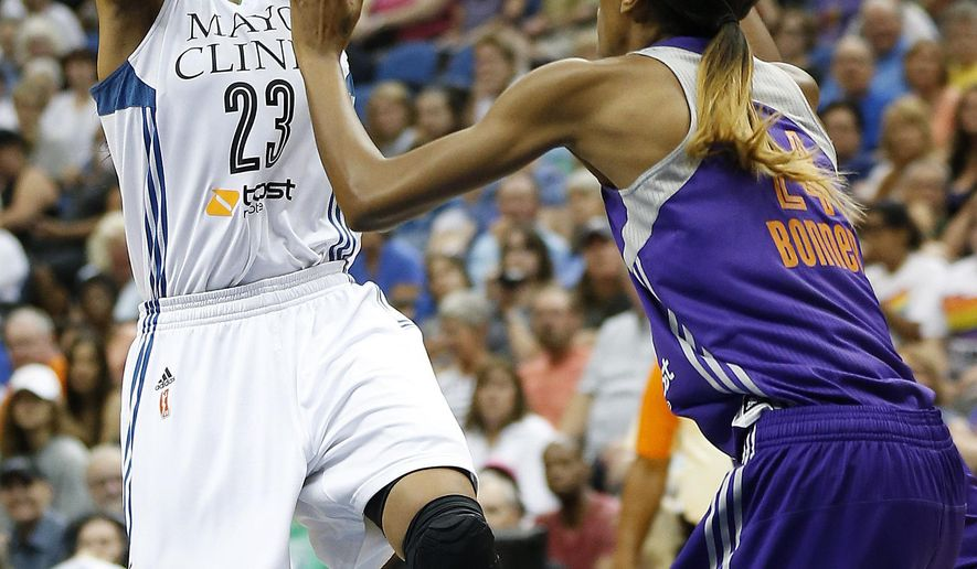 Minnesota Lynx forward Maya Moore (23) tries to shoot against the defense of Phoenix Mercury guard DeWanna Bonner (24) during the first half of a WNBA basketball game, Saturday, June 27, 2015, in Minneapolis. (AP Photo/Stacy Bengs)