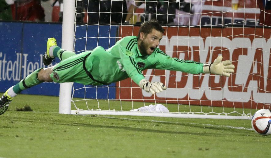 Houston Dynamo goalkeeper Tyler Deric cannot reach shot, allowing a goal by FC Dallas forward Fabian Castillo, during the first half of an MLS soccer game in Frisco, Texas, Friday, June 26, 2015. (AP Photo/LM Otero)
