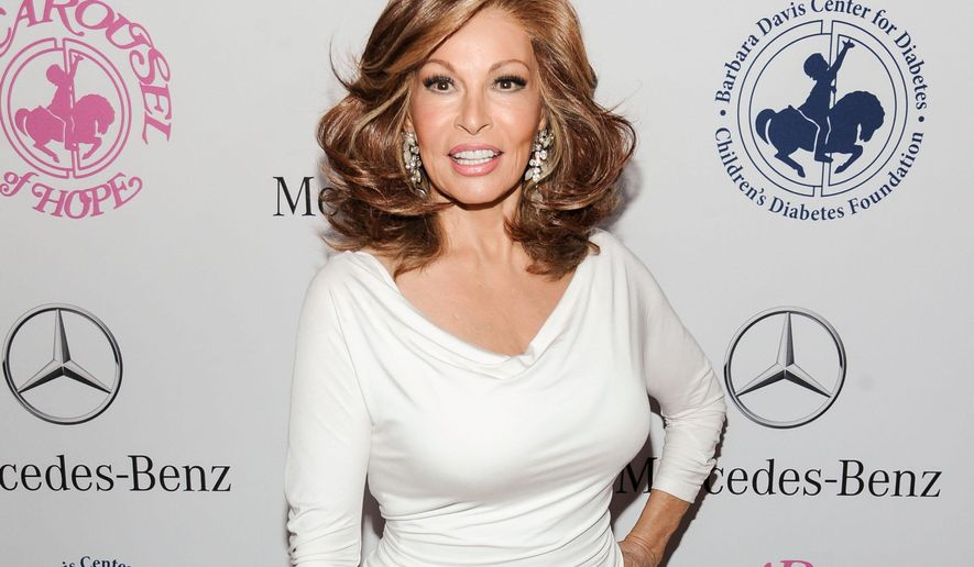 FILE - In this Oct. 11, 2014 file photo, Raquel Welch arrives at the 2014 Carousel Of Hope Ball in Beverly Hills, Calif. Welch will be honored on Saturday, June 27, 2015, with a Lifetime Achievement Award by the National Association of Latino Independent Producers. (Photo by Richard Shotwell/Invision/AP, File)
