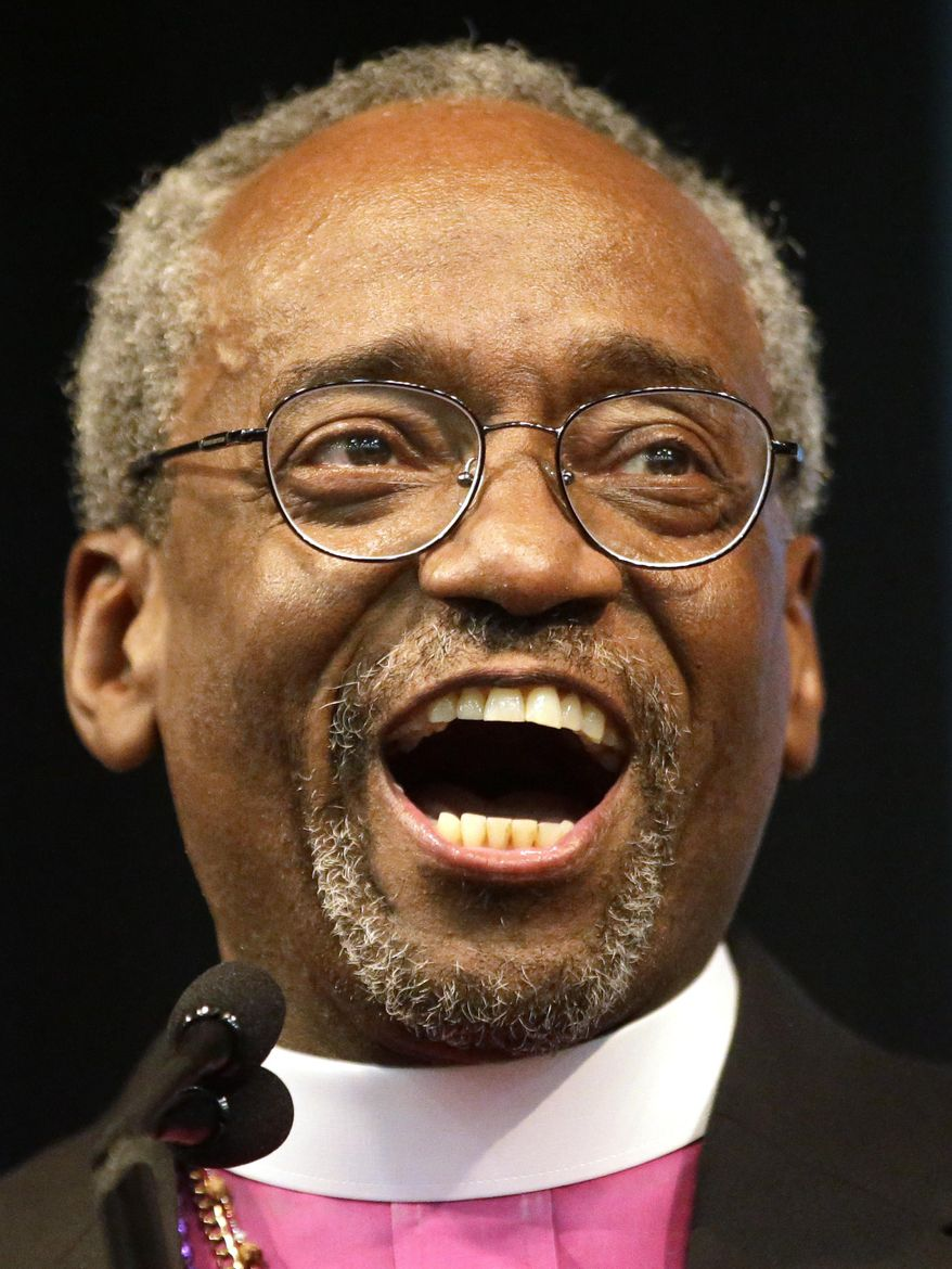 Bishop Michael Curry of North Carolina, celebrates after being elected the Episcopal Church's first African-American presiding bishop at the Episcopal General Convention Saturday, June 27, 2015, in Salt Lake City. Curry won the vote in a landslide. (AP Photo/Rick Bowmer)