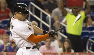 Miami Marlins' Giancarlo Stanton (27) breaks his bat on an out during the second inning of a baseball game against the St. Louis Cardinals, in Miami, Thursday, June 25, 2015. (AP Photo/J Pat Carter)