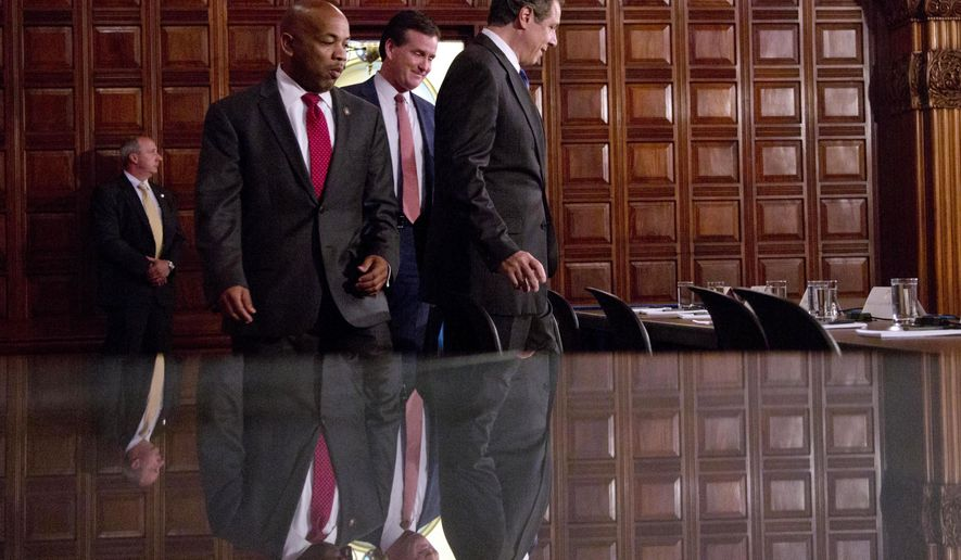 FILE--In this June 25, 2015 file photo, Assembly Speaker Carl Heastie, D-Bronx, left, Senate Majority Leader John Flanagan, R-Smithtown, center, and Gov. Andrew Cuomo arrive for a news conference in the Red Room at the Capitol in Albany, N.Y.  As New York lawmakers went late into overtime this week, most politicians claimed at least limited constituent wins from rent controls and property tax breaks. (AP Photo/Mike Groll, File)