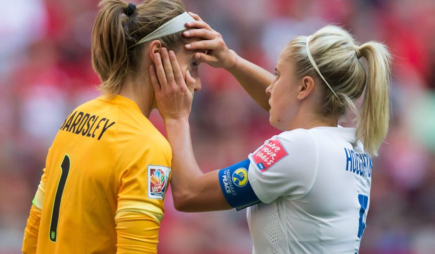 England's Steph Houghton, right, checks the eye of goalkeeper Karen Bardsley during second half against Canada in a quarterfinal of the Women's World Cup soccer tournament, Saturday, June 27, 2015, in Vancouver, British Columbia, Canada. Bardsley left the game and was replaced Siobhan Chamberlain. (Darryl Dyck/The Canadian Press via AP)