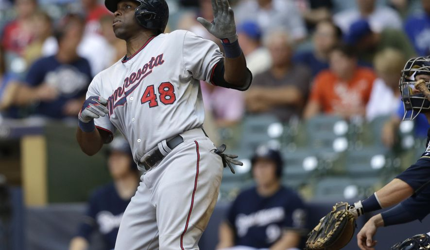 Minnesota Twins' Torii Hunter watches his home run during the sixth inning of a baseball game against the Milwaukee Brewers Saturday, June 27, 2015, in Milwaukee. (AP Photo/Jeffrey Phelps)