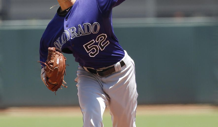 Colorado Rockies pitcher Chris Rusin throws to the San Francisco Giants during the first inning of a baseball game, Saturday, June 27, 2015, in San Francisco. (AP Photo/George Nikitin)