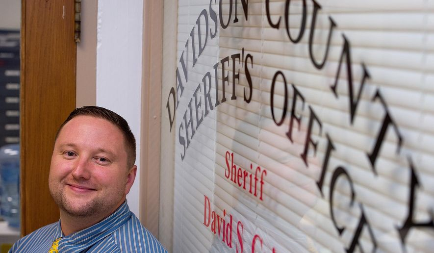 In this May 28, 2015, photo, Det. Charlie Goforth of the Davidson County Sheriff's Office Criminal Investigation Division,  poses in the Sheriff's Office in Lexington, N.C. . Goforth is still recovering from a gunshot wound to his foot during a home invasion investigation in 2013.  (Donnie Roberts/The Dispatch via AP)