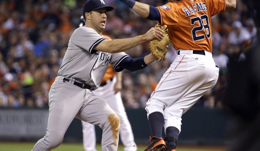 New York Yankees first baseman Mark Teixeira, left, tags out Houston Astros' Colby Rasmus (28) during the ninth inning of a baseball game Friday, June 26, 2015, in Houston. (AP Photo/David J. Phillip)