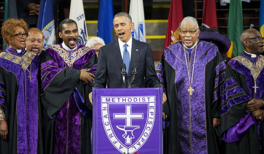 """President Barack Obama sings """"Amazing Grace"""" during services honoring the life of Rev. Clementa Pinckney, Friday, June 26, 2015, at the College of Charleston TD Arena in Charleston, S.C.. Pinckney was one of the nine people killed in the shooting at Emanuel AME Church last week in Charleston. (AP Photo/David Goldman)"""