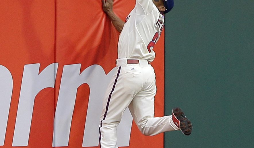 Philadelphia Phillies center fielder Ben Revere catches a fly-out by Washington Nationals' Tyler Moore during the second inning of a baseball game, Saturday, June 27, 2015, in Philadelphia. (AP Photo/Matt Slocum)