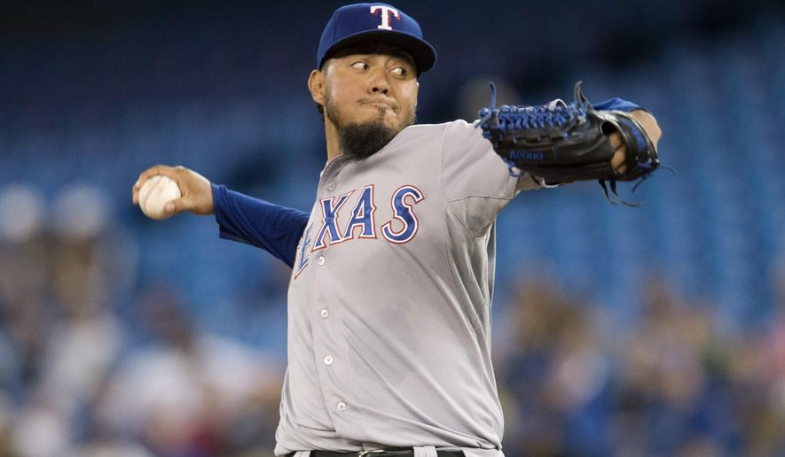 Texas Rangers starting pitcher Yovani Gallardo works against the Toronto Blue Jays during the first inning of a baseball game in Toronto on Saturday, June 27, 2015. (Darren Calabrese/The Canadian Press via AP) MANDATORY CREDIT