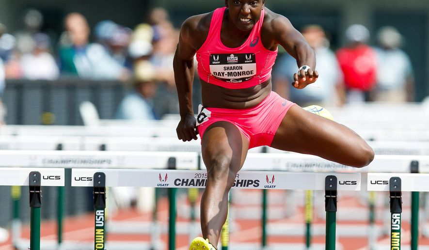 Sharon Day-Monroe clears the last hurdle in the 100 meter hurdles of the heptathlon competition at the U.S. Track and Field Championships in Eugene, Ore., Saturday, June 27, 2015. (AP Photo/Ryan Kang)