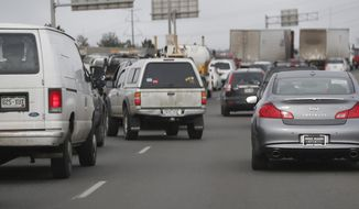 Traffic comes to a halt as motorists try to enter lanes on Interstate 25 northbound out of downtown Denver on Feb. 20, 2015. (Associated Press) **FILE**