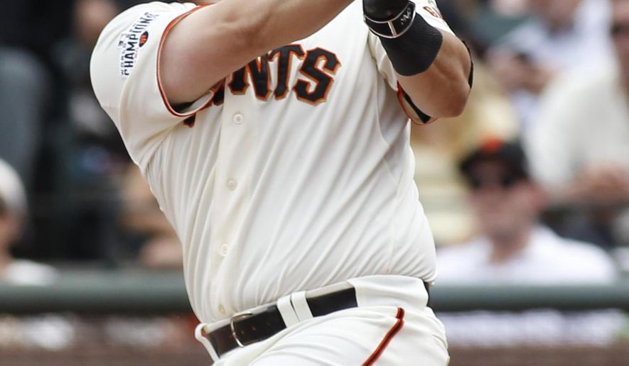 San Francisco Giants' Andrew Susac hits a three-run double against the Colorado Rockies during the seventh inning of a baseball game, Saturday, June 27, 2015, in San Francisco. (AP Photo/George Nikitin)