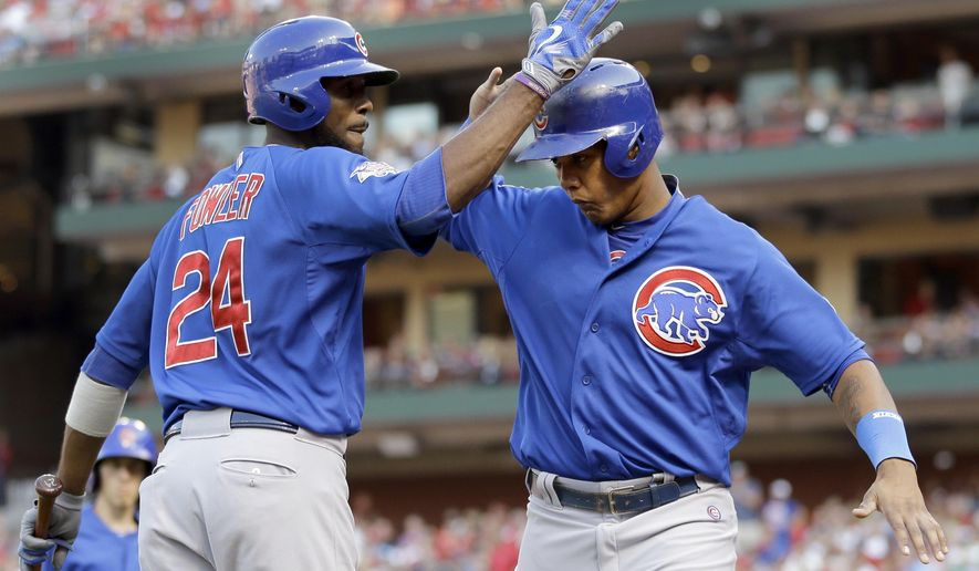 Chicago Cubs' Starlin Castro, right, is congratulated by teammate Dexter Fowler after scoring on a single by Donn Roach during the second inning of a baseball game against the St. Louis Cardinals Saturday, June 27, 2015, in St. Louis. (AP Photo/Jeff Roberson)
