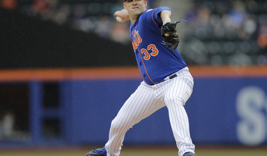 New York Mets' Matt Harvey delivers a pitch during the first inning of a baseball game against the Cincinnati Reds Saturday, June 27, 2015, in New York. (AP Photo/Frank Franklin II)