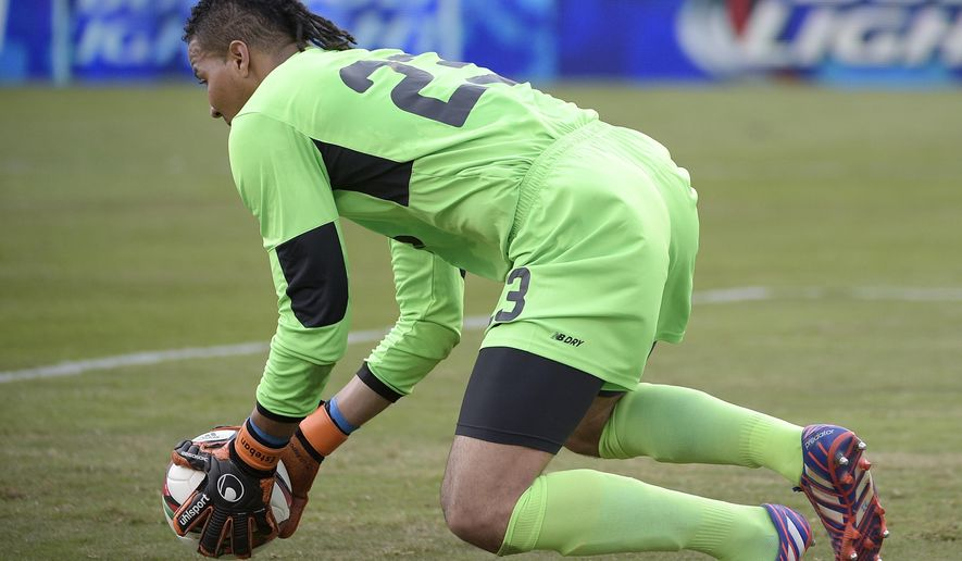 Costa Rica goalkeeper Esteban Alvarado (23) makes a save in front of the goal during the first half of a friendly soccer match against Mexico in Orlando, Fla., Saturday, June 27, 2015. (AP Photo/Phelan M. Ebenhack)