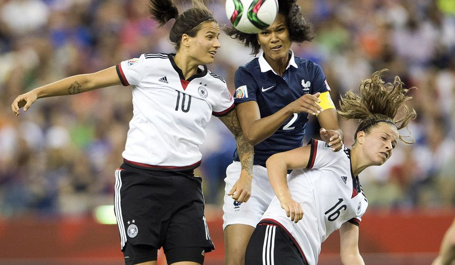 Germany's Dzsenifer Marozsan, left, and Melanie Leupolz, right, battle with France's Wendie Renard during the second half of a quarterfinal match in the FIFA Women's World Cup soccer tournament, Friday, June 26, 2015, in Montreal, Canada. (Ryan Remiorz/The Canadian Press via AP) MANDATORY CREDIT