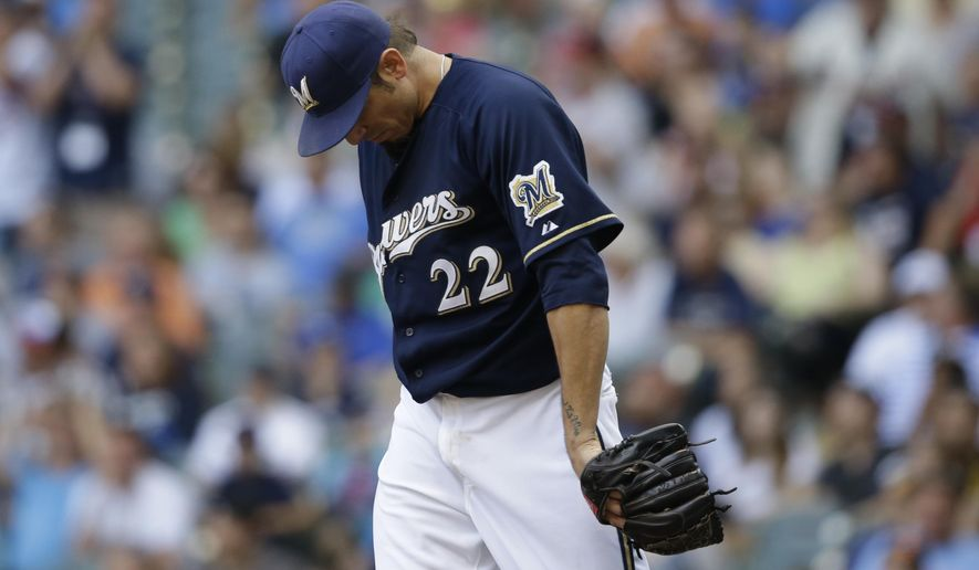 Milwaukee Brewers starting pitcher Matt Garza hangs his head after giving up a home run to the Minnesota Twins' Torii Hunter during the sixth inning of a baseball game against the Milwaukee Brewers Saturday, June 27, 2015, in Milwaukee. (AP Photo/Jeffrey Phelps)