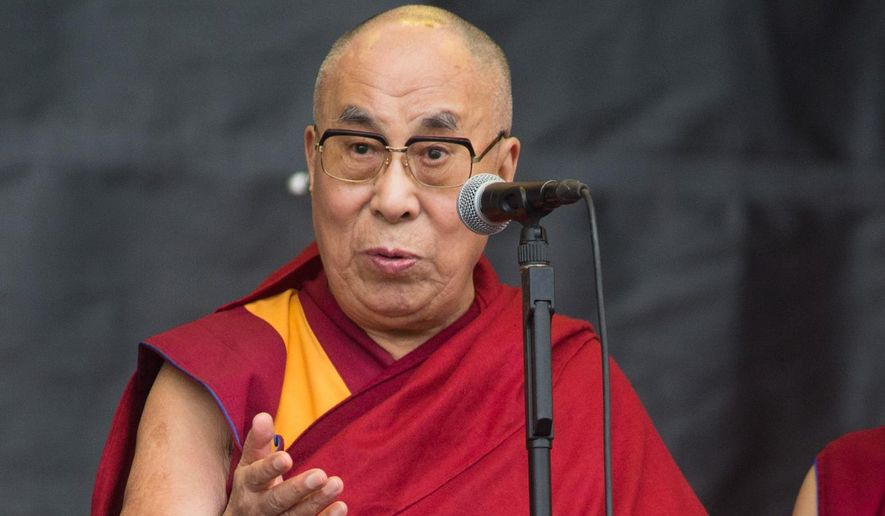 The Dalai Lama speaks to the crowd during the Glastonbury music festival on Sunday, June 28, 2015 at Worthy Farm, Glastonbury, England. (Photo by Jim Ross/Invision/AP)