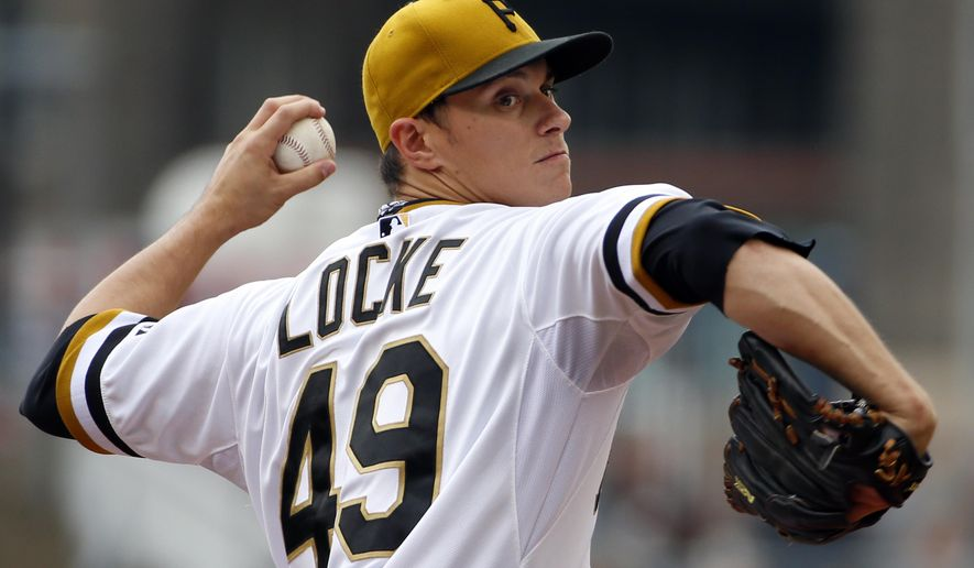 Pittsburgh Pirates starting pitcher Jeff Locke (49) delivers in the first inning of a baseball game against the Atlanta Braves in Pittsburgh, Sunday, June 28, 2015. (AP Photo/Gene J. Puskar)