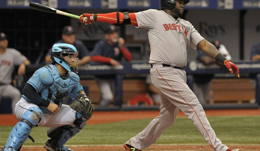 Tampa Bay Rays catcher Rene Rivera, left, looks on as Boston Red Sox designated hitter David Ortiz hits a two-run home run to right during the fourth inning of a baseball game Sunday, June 28, 2015, in St. Petersburg, Fla. (AP Photo/Steve Nesius)