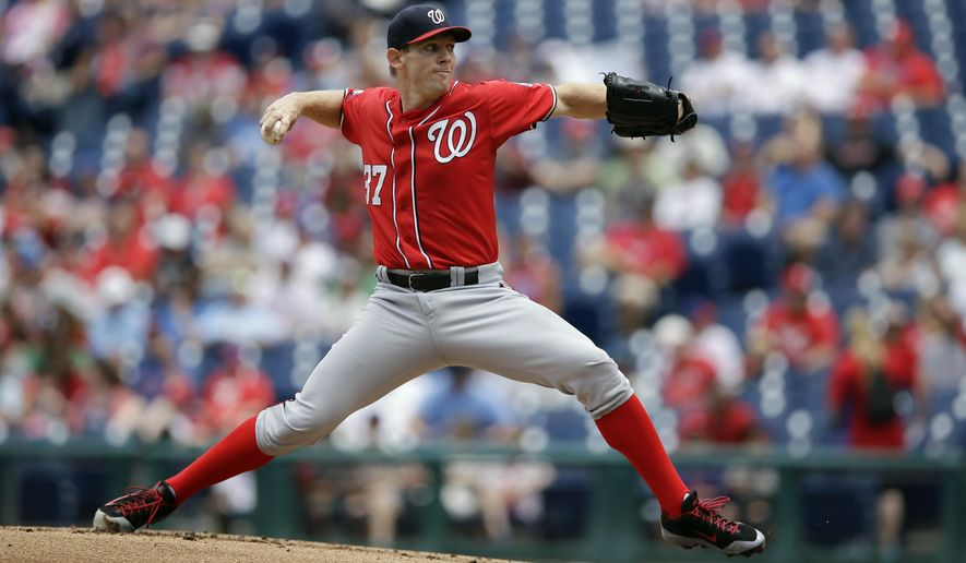 Washington Nationals' Stephen Strasburg pitches during the first inning of the first game of a baseball doubleheader against the Philadelphia Phillies, Sunday, June 28, 2015, in Philadelphia. (AP Photo/Matt Slocum)