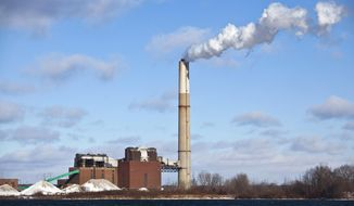 This Dec. 13, 2010, file photo shows CMS Energy Corp.'s B.C. Cobb Plant in Muskegon, Mich. (Jeffrey Ball, The Muskegon Chronicle via AP) ** FILE **