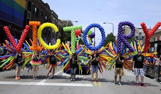 People celebrate during the 46th Annual Chicago Pride Parade, Sunday, June 28, 2015, in Chicago. A large turnout was expected for gay pride parades across the U.S. following the landmark Supreme Court ruling that said gay couples can marry anywhere in the country. (AP Photo/Nam Y. Huh)