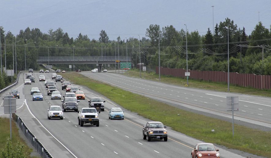 This photo taken Thursday, June 25, 2015, shows inbound morning rush hour traffic on the Glenn Highway from the Bragaw Street overpass in Anchorage, Alaska. U.S. Census figures show Anchorage commuters have a daily commute of 23 minutes, below the national average but a longer commute than in other cities with smaller populations. (AP Photo/Mark Thiessen)