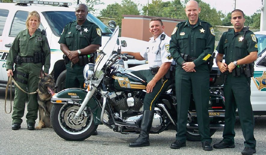 The National Sheriffs' Association annual conference stages its own presidential forum before an audience of 3,000 on Monday; this team is from the Osceola County Florida Sheriff's Office.