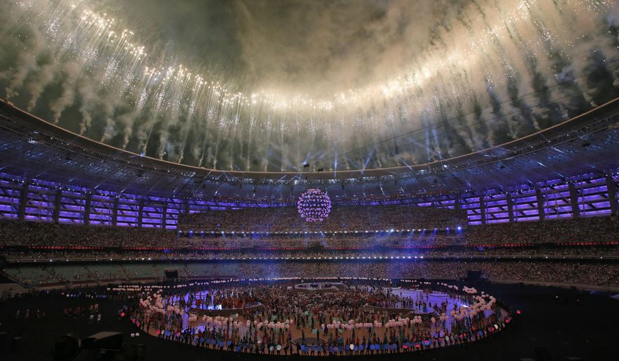 Firework explodes above the Baku Olympic stadium during the closing ceremony of the 2015 European Games in Baku, Azerbaijan, Sunday, June 28, 2015. (AP Photo/Dmitry Lovetsky)